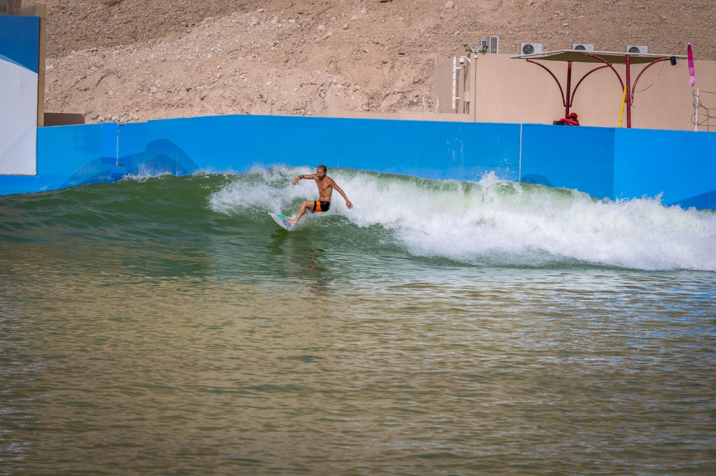 Surfer in wave pool in the desert in Dubai