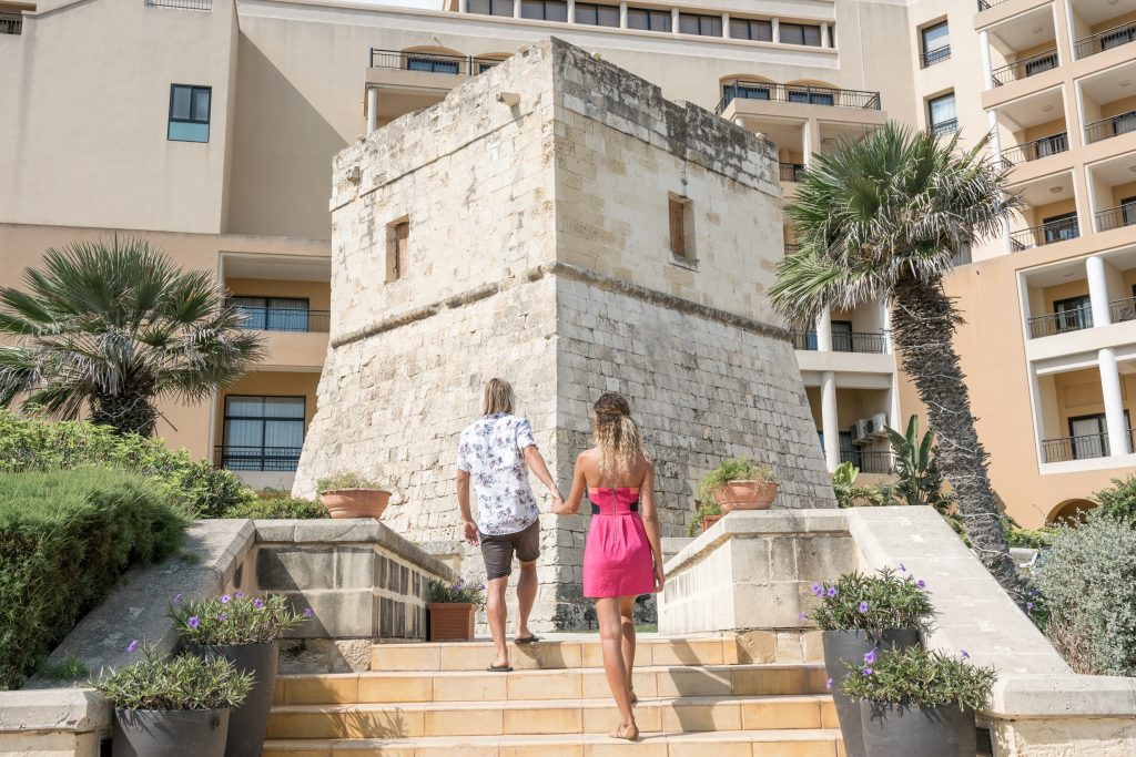 Travel couple at Corinthia Hotel St. George's Bay Malta